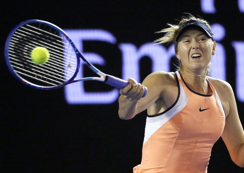 FILE - In this Wednesday, Jan. 20, 2016 file photo, Maria Sharapova of Russia hits a forehand return to Aliaksandra Sasnovich of Belarus during their second round match at the Australian Open tennis championships in Melbourne, Australia. (AP Photo/Vincent Thian)