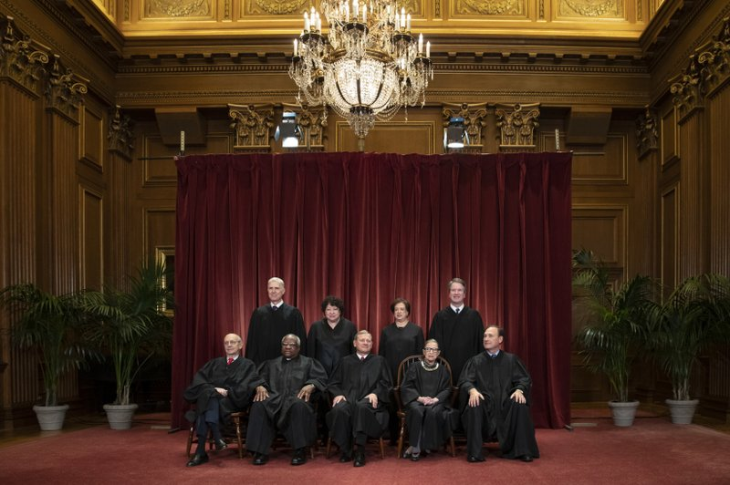 FILE - In this Nov. 30, 2018, file photo, the justices of the U.S. Supreme Court gather for a formal group portrait to include a new Associate Justice, top row, far right, at the Supreme Court Building in Washington. (AP Photo/J. Scott Applewhite, File)