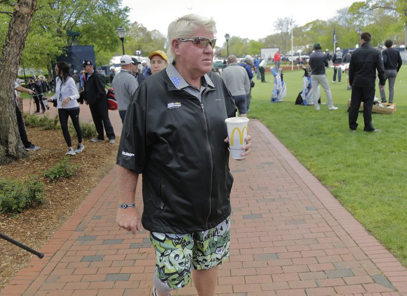 John Daly walks around the putting green before playing a practice round for the PGA Championship golf tournament, Wednesday, May 15, 2019, at Bethpage Black in Farmingdale, N. (AP Photo/Seth Wenig)