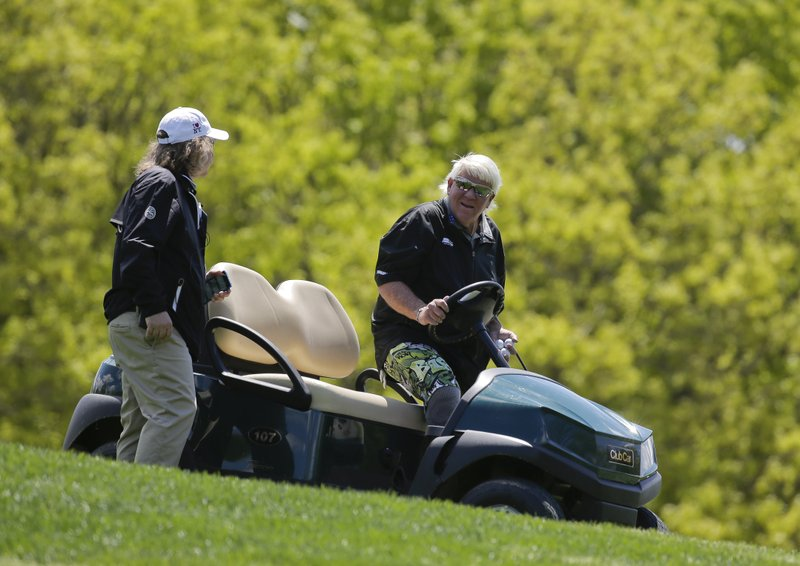 John Daly gets into a golf cart after teeing off on the fifth hole during a practice round for the PGA Championship golf tournament, Wednesday, May 15, 2019, at Bethpage Black in Farmingdale, N. (AP Photo/Seth Wenig)