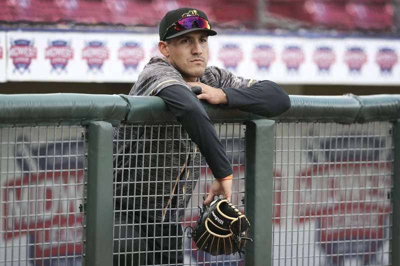 In this Monday, May 13, 2019 photo, Quad Cities River Bandits outfielder Alex McKenna stands in the dugout before a Class-A Midwest League baseball game against the Cedar Rapids Kernels in Cedar Rapids, Iowa. (AP Photo/Charlie Neibergall)
