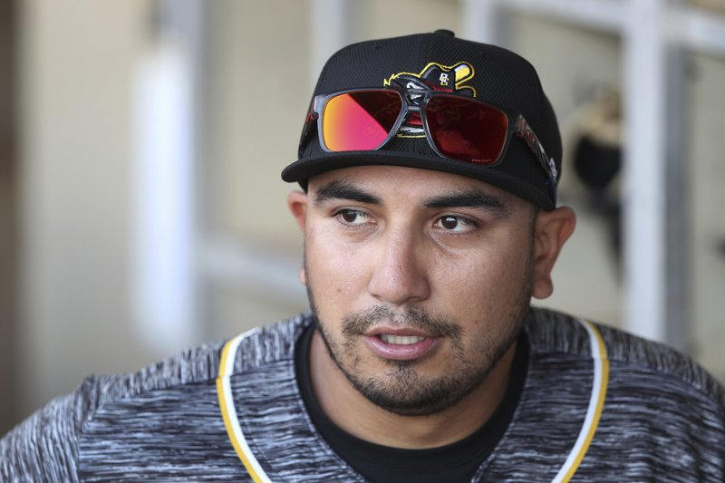 In this Monday, May 13, 2019 photo, Quad Cities River Bandits manager Ray Hernandez stands in the dugout before a Class-A Midwest League baseball game against the Cedar Rapids Kernels in Cedar Rapids, Iowa. (AP Photo/Charlie Neibergall)
