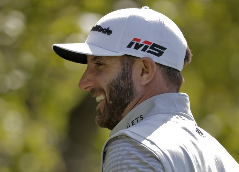 Dustin Johnson reacts before teeing off on the eighth hole during a practice round for the PGA Championship golf tournament, Wednesday, May 15, 2019, at Bethpage Black in Farmingdale, N. (AP Photo/Julio Cortez)