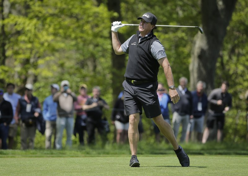 Phil Mickelson watches his approach shot on the 13th fairway during a practice round for the PGA Championship golf tournament, Wednesday, May 15, 2019, at Bethpage Black in Farmingdale, N. (AP Photo/Seth Wenig)