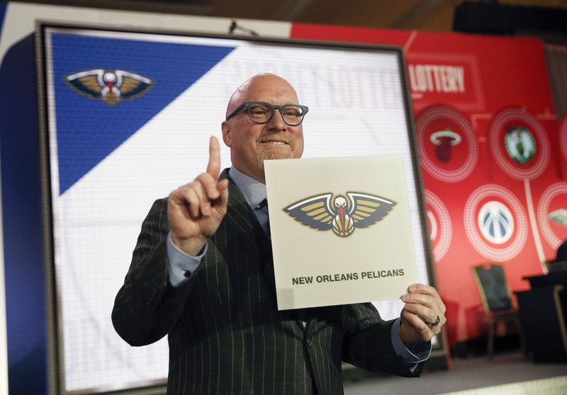David Griffin, Executive Vice President of basketball operations for the New Orleans Pelicans holds up a placard after it was announced that his team had won the first pick during the NBA basketball draft lottery Tuesday, May 14, 2019, in Chicago. (AP Photo/Nuccio DiNuzzo)