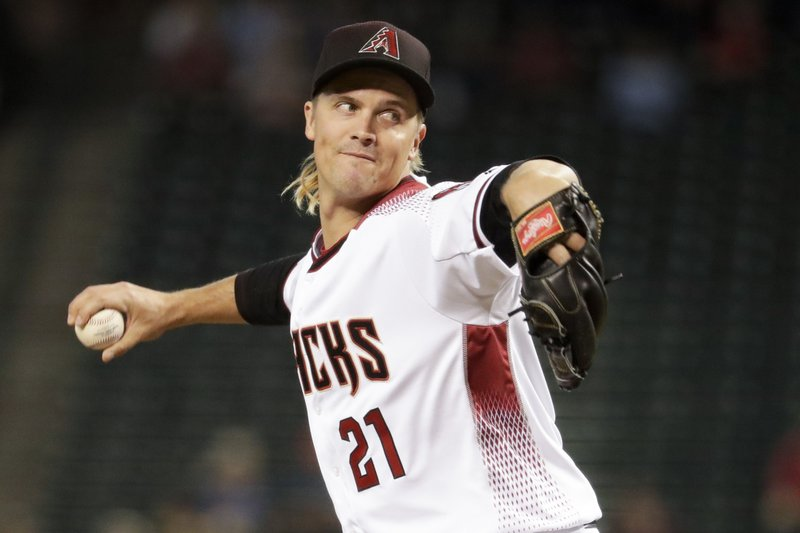 Arizona Diamondbacks starting pitcher Zack Greinke throws against the Pittsburgh Pirates during the first inning of a baseball game in Phoenix, Wednesday, May 15, 2019. (AP Photo/Matt York)