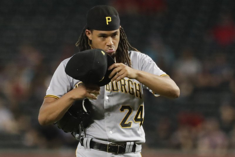 Pittsburgh Pirates starting pitcher Chris Archer walks off the mound after giving up tree run against the Arizona Diamondbacks during the top of the first inning of a baseball game in Phoenix, Wednesday, May 15, 2019. (AP Photo/Matt York)