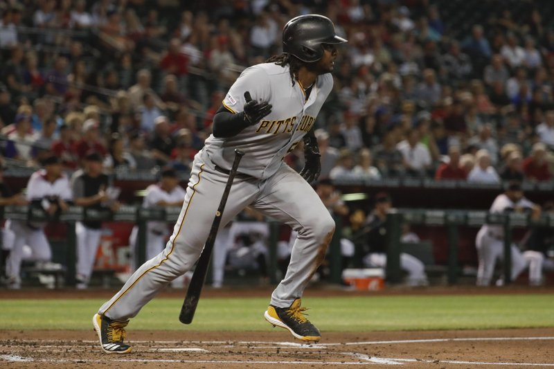 Pittsburgh Pirates' Josh Bell watches his double against the Arizona Diamondbacks during the second inning of a baseball game in Phoenix, Wednesday, May 15, 2019. (AP Photo/Matt York)