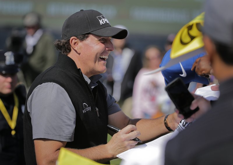 Phil Mickelson reacts as he signs autographs after finishing a practice round for the PGA Championship golf tournament, Wednesday, May 15, 2019, at Bethpage Black in Farmingdale, N. (AP Photo/Seth Wenig)