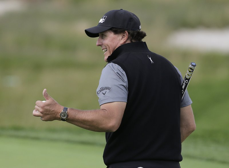 Phil Mickelson motions to fans during a practice round for the PGA Championship golf tournament, Wednesday, May 15, 2019, at Bethpage Black in Farmingdale, N. (AP Photo/Seth Wenig)