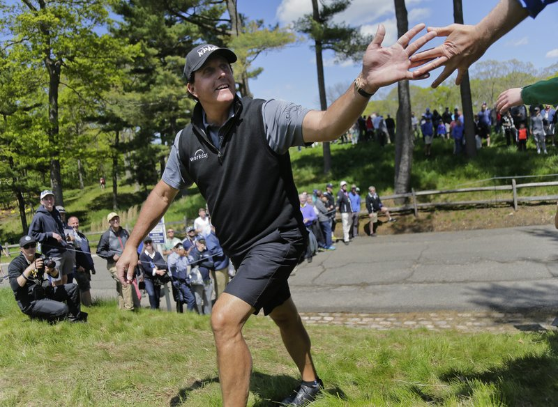 Phil Mickelson greets fans on his way to the 13th tee during a practice round for the PGA Championship golf tournament, Wednesday, May 15, 2019, at Bethpage Black in Farmingdale, N. (AP Photo/Seth Wenig)