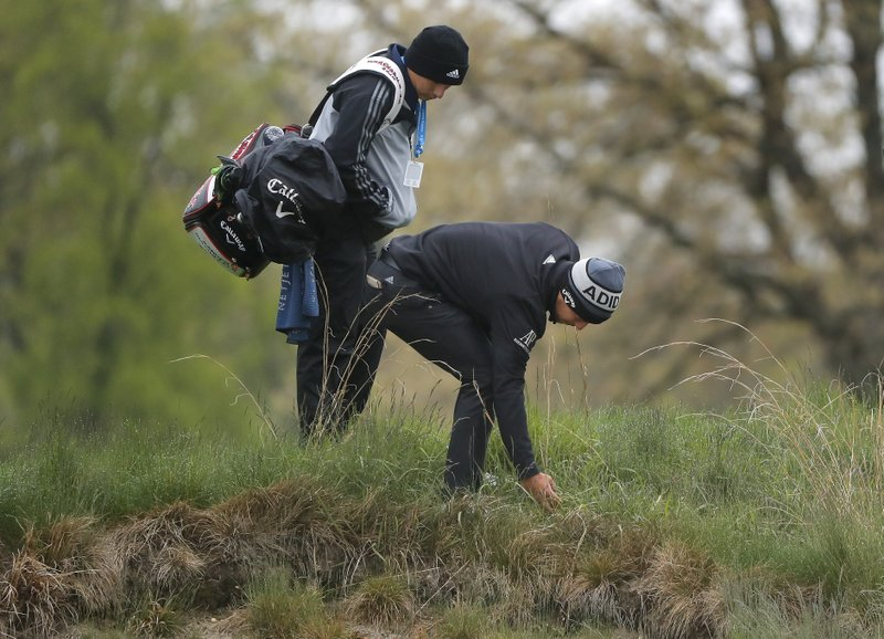 Xander Schauffele, picks his ball out of the rough on the 4th hole during a practice round for the PGA Championship golf tournament, Monday, May 13, 2019, at Bethpage Black in Farmingdale, N. (AP Photo/Julie Jacobson)