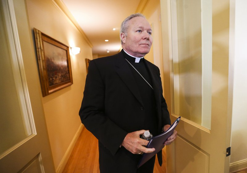 Dallas Bishop Edward J. Burns enters a room to speak to the media following a police raid on several Diocese of Dallas offices, Wednesday, May 15, 2019, at Holy Trinity Catholic Church in Dallas. (Ryan Michalesko/The Dallas Morning News via AP)