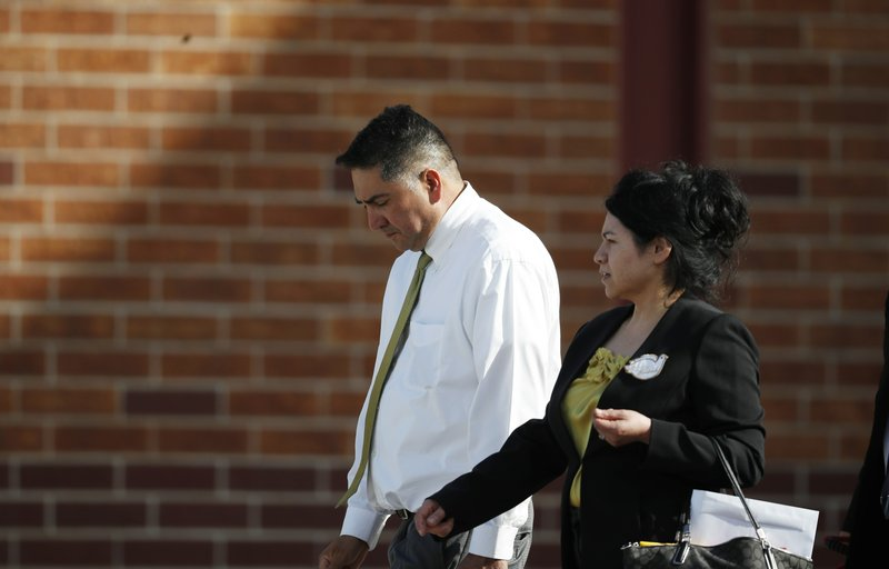 John and Maria Castillo, leave after the memorial service for their son, Kendrick, who was killed in the assault on the STEM Highlands Ranch School, Wednesday, May 15, 2019, in Highlands Ranch, Colo. (AP Photo/David Zalubowski)