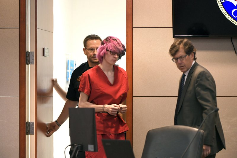 Devon Erickson, center, appears in court at the Douglas County Courthouse on Wednesday, May 15, 2019, in Castle Rock, Colo. (Joe Amon/The Denver Post via AP, Pool)