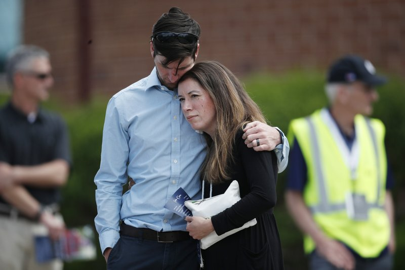 A young couple embrace after the memorial service for Kendrick Castillo, who was killed in the assault on the STEM Highlands Ranch School, Wednesday, May 15, 2019, in Highlands Ranch, Colo. (AP Photo/David Zalubowski)