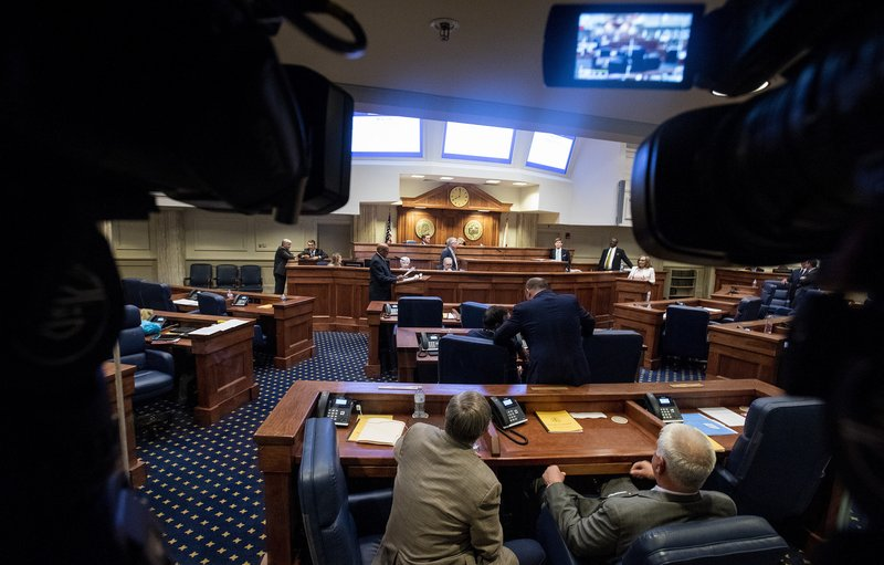 Lawmakers debate a ban on nearly all abortions in the senate chamber in the Alabama State House in Montgomery, Ala. (Mickey Welsh/The Montgomery Advertiser via AP)