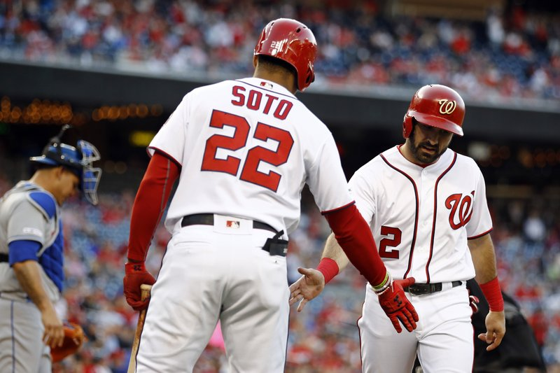 Washington Nationals' Adam Eaton, right, celebrates with teammate Juan Soto after scoring on a ground rule double that was hit by Anthony Rendon in the first inning of a baseball game against the New York Mets, Wednesday, May 15, 2019, in Washington. (AP Photo/Patrick Semansky)