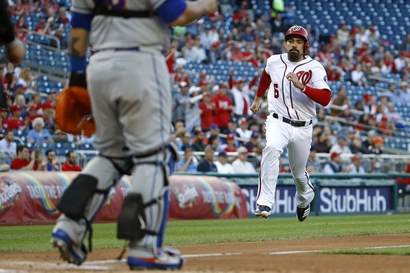 Washington Nationals' Anthony Rendon races home toward New York Mets catcher Wilson Ramos for a run on Howie Kendrick's single in the first inning of a baseball game, Wednesday, May 15, 2019, in Washington. (AP Photo/Patrick Semansky)