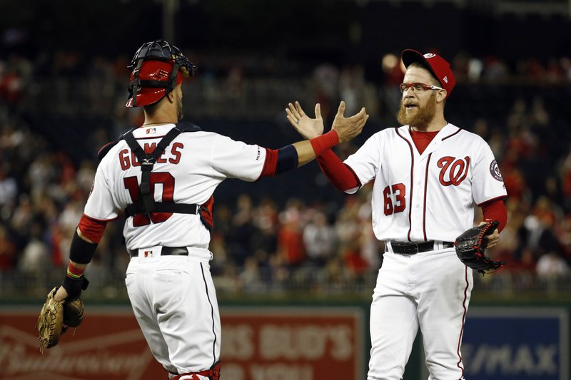 Washington Nationals catcher Yan Gomes, left, and relief pitcher Sean Doolittle celebrate after closing out a baseball game against the New York Mets, Wednesday, May 15, 2019, in Washington. (AP Photo/Patrick Semansky)
