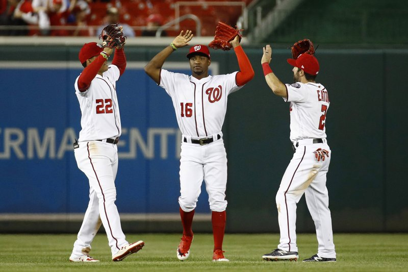 Washington Nationals outfielders Juan Soto, from left, Victor Robles and Adam Eaton celebrate after a baseball game against the New York Mets, Wednesday, May 15, 2019, in Washington. (AP Photo/Patrick Semansky)