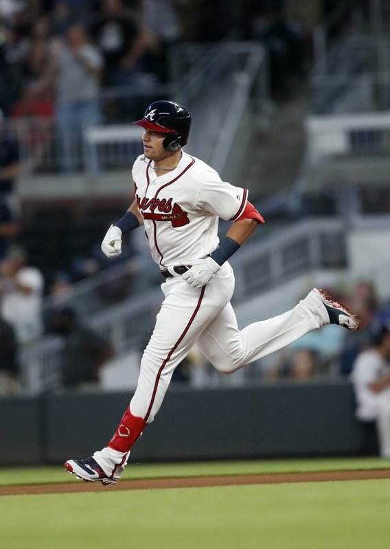 Atlanta Braves' rookie Austin Riley rounds the bases after hitting a home run in the fourth inning of a baseball game against the St. (AP Photo/John Bazemore)