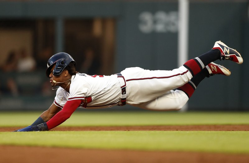 Atlanta Braves' Ronald Acuna Jr. (13) dives head first as he steals second base in the third inning of a baseball game against the St. (AP Photo/John Bazemore)