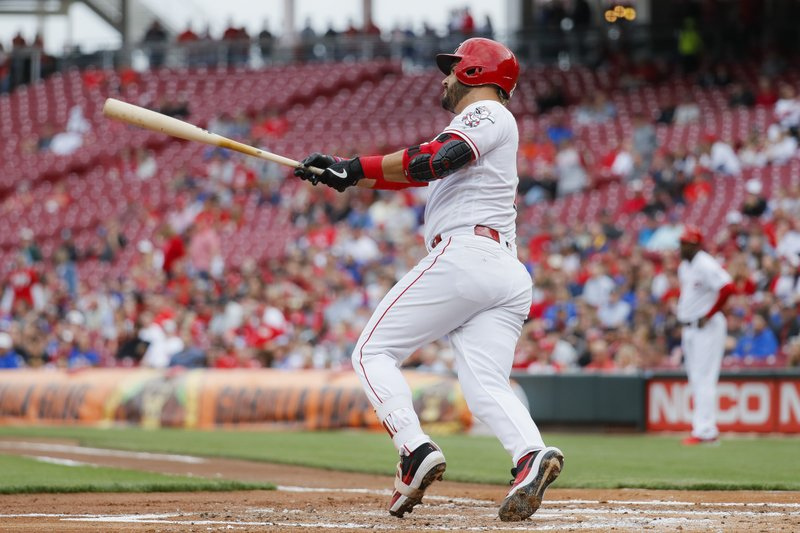 Cincinnati Reds' Eugenio Suarez hits an RBI double off Chicago Cubs starting pitcher Yu Darvish in the first inning of a baseball game, Wednesday, May 15, 2019, in Cincinnati. (AP Photo/John Minchillo)