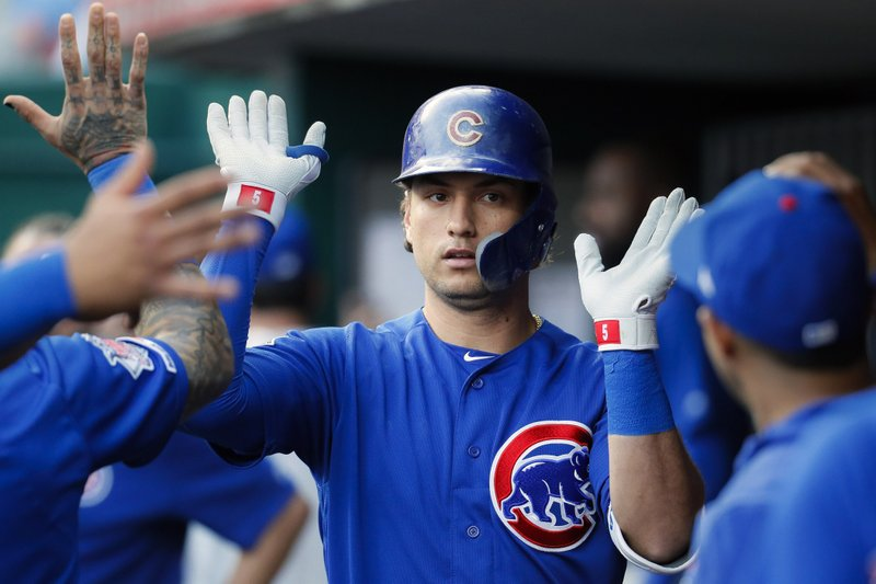 Chicago Cubs' Albert Almora Jr. celebrates in the dugout after hitting a solo home run off Cincinnati Reds starting pitcher Sonny Gray in the fourth inning of a baseball game, Wednesday, May 15, 2019, in Cincinnati. (AP Photo/John Minchillo)
