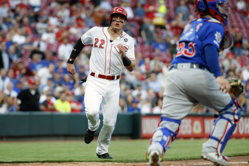 Cincinnati Reds' Derek Dietrich (22) runs how to score on a RBI double by Jose Iglesias off Chicago Cubs starting pitcher Yu Darvish in the fourth inning of a baseball game, Wednesday, May 15, 2019, in Cincinnati. (AP Photo/John Minchillo)