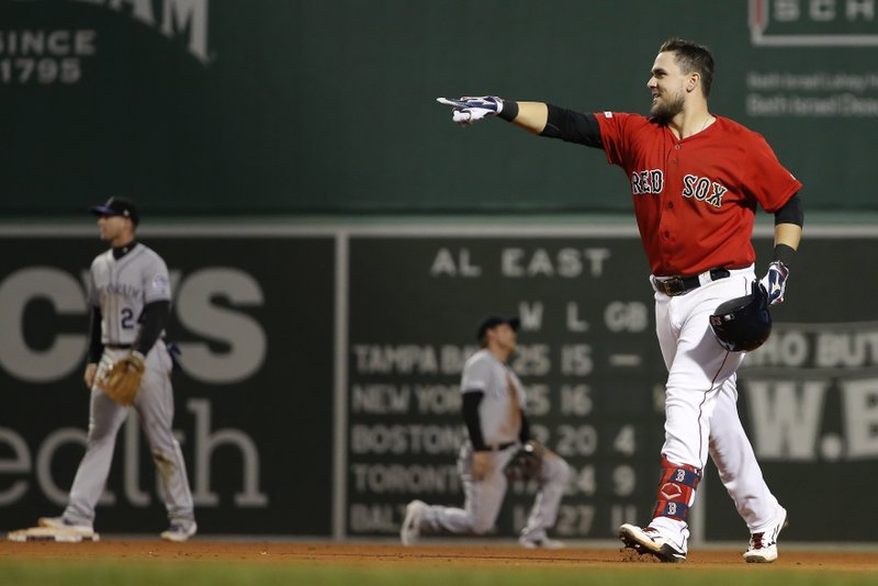 Boston Red Sox's Michael Chavis celebrates his games-ending single against the Colorado Rockies during the 10th inning of a baseball game Wednesday, May 15, 2019, at Fenway Park in Boston. (AP Photo/Winslow Townson)