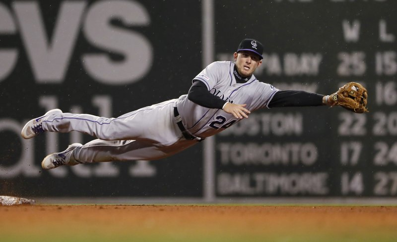 Colorado Rockies' Ryan McMahon leaps to grab a wide throw on a steal of second base by Boston Red Sox's Christian Vazquez during the fifth inning of a baseball game Wednesday, May 15, 2019, at Fenway Park in Boston. (AP Photo/Winslow Townson)