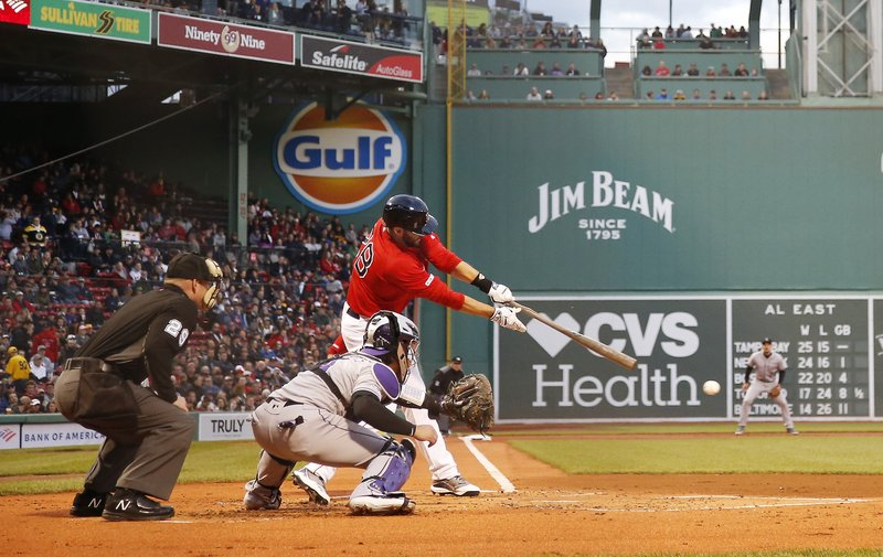 Boston Red Sox's J.D. Martinez connects for an RBI single against the Colorado Rockies during the first inning of a baseball game Wednesday, May 15, 2019, at Fenway Park in Boston. (AP Photo/Winslow Townson)