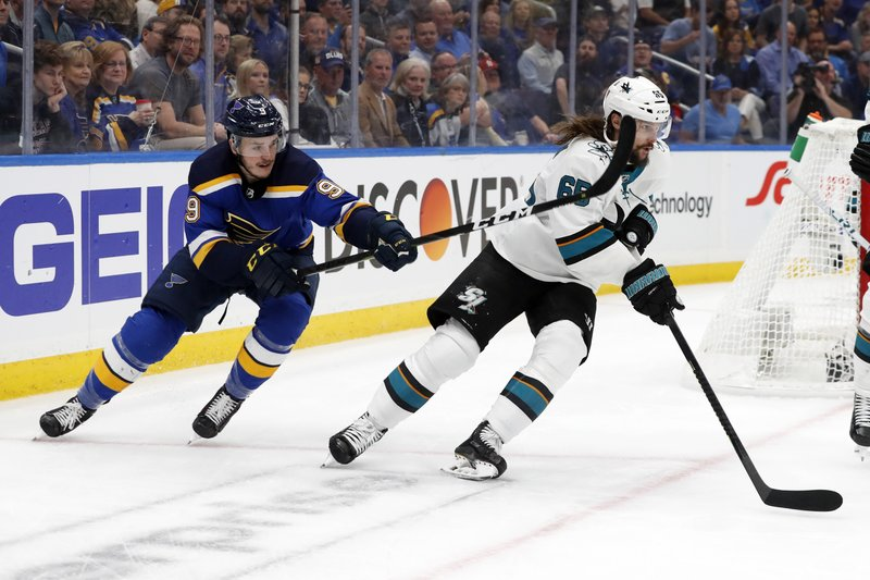 St. Louis Blues left wing Sammy Blais (9) tries to slow down San Jose Sharks defenseman Erik Karlsson (65), of Sweden, during the third period in Game 3 of the NHL hockey Stanley Cup Western Conference final series Wednesday, May 15, 2019, in St. (AP Photo/Jeff Roberson)