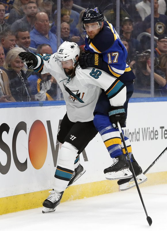 St. Louis Blues left wing Jaden Schwartz (17) lands on the back of San Jose Sharks defenseman Erik Karlsson (65), of Sweden, during the third period in Game 3 of the NHL hockey Stanley Cup Western Conference final series Wednesday, May 15, 2019, in St. (AP Photo/Jeff Roberson)