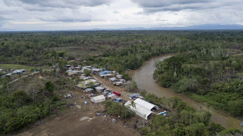 This May 10, 2019 photo, shows the indigenous village of Peñitas, Darien Province, Panama. In normal times Peñitas has fewer than 200 inhabitants who ply the Chucunaque river in narrow wooden skiffs, with no running water, cell coverage, medical clinic or regular transportation. (AP Photo/Arnulfo Franco)