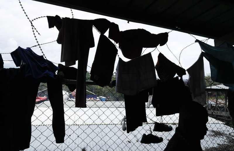 In this May 10, 2019 photo, migrant's clothes are hung on barbed wire to dry at a shelter in Peñitas, Darien Province, Panama. (AP Photo/Arnulfo Franco)