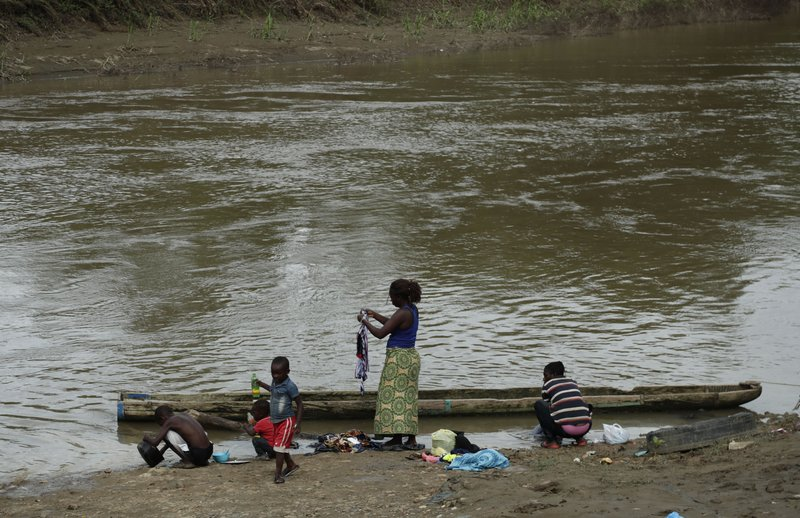 In this May 10, 2019, migrants wash their clothes on the Chucunaque river in Peñitas, Darien Province, Panama. (AP Photo/Arnulfo Franco)