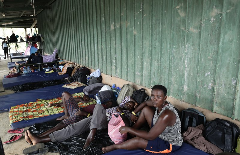 In May 10, 2019 photo, migrants from several African countries rest on mattresses outside a barn used as a shelter in Peñitas, Darien Province, Panama. (AP Photo/Arnulfo Franco)