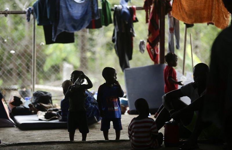 In this May 10, 2019, migrant children play inside a barn used as a shelter in Peñitas, Darien Province, Panama. (AP Photo/Arnulfo Franco)
