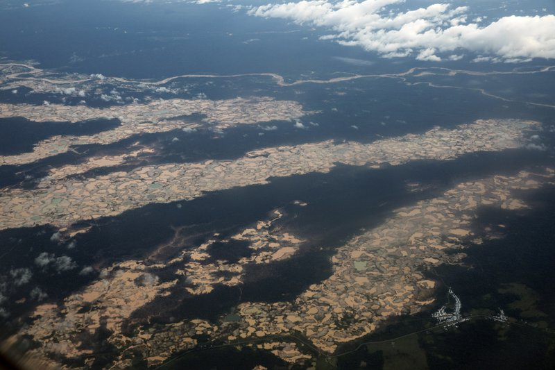 This March 26, 2019 photo shows an aerial view of thousands of destroyed hectares of Amazon jungle by illegal miners, in the Tambopata province, one of three that make up Peru's Madre de Dios department. (AP Photo/Rodrigo Abd)