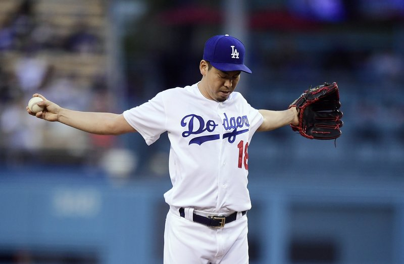 Los Angeles Dodgers starting pitcher Kenta Maeda, of Japan, gets set to pitch during the first inning of a baseball game against the San Diego Padres Wednesday, May 15, 2019, in Los Angeles. (AP Photo/Mark J. Terrill)