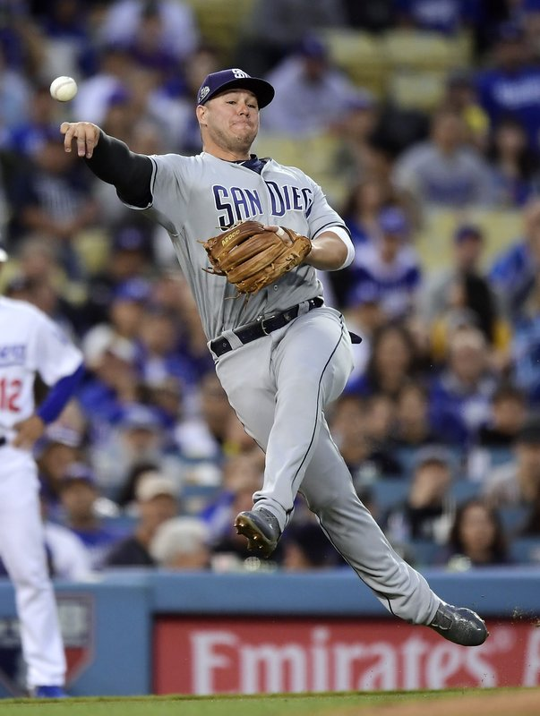 San Diego Padres third baseman Ty France attempts to throw out Los Angeles Dodgers' Corey Seager at first during the second inning of a baseball game Wednesday, May 15, 2019, in Los Angeles. (AP Photo/Mark J. Terrill)