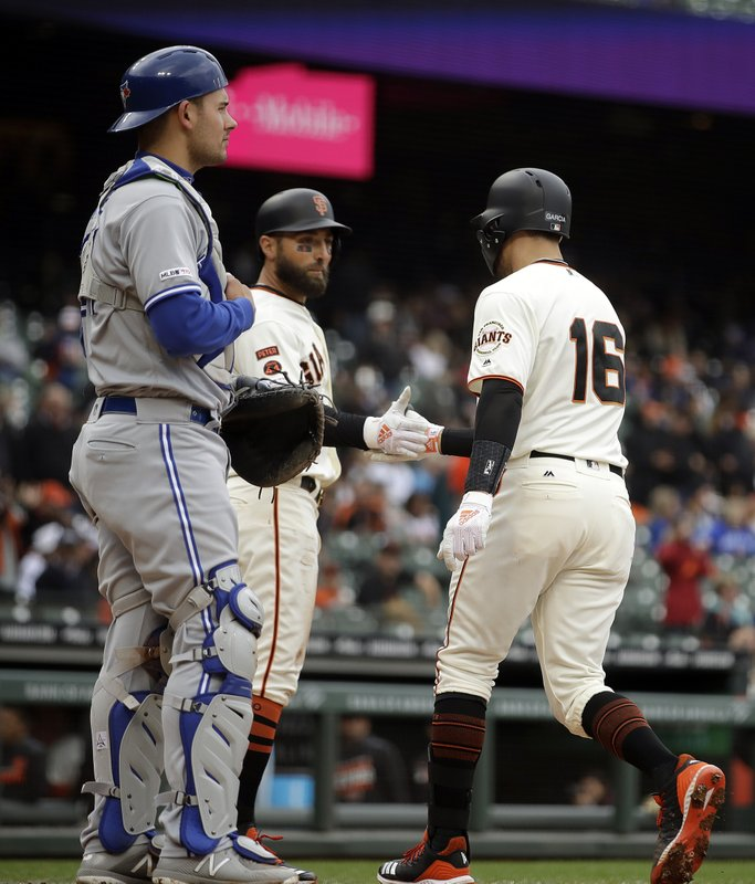 San Francisco Giants' Aramis Garcia (16) is congratulated by Kevin Pillar after hitting a two run home run off Toronto Blue Jays' Edwin Jackson in the second inning of a baseball game Wednesday, May 15, 2019, in San Francisco. (AP Photo/Ben Margot)