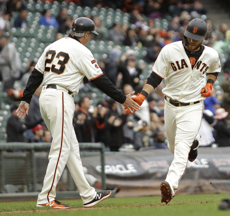 San Francisco Giants' Brandon Crawford, right, is congratulated by third base coach Ron Wotus (23) after hitting a home run in the sixth inning of a baseball game against the Toronto Blue Jays Wednesday, May 15, 2019, in San Francisco. (AP Photo/Ben Margot)
