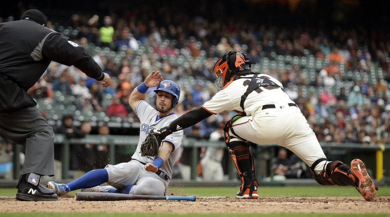 San Francisco Giants catcher Aramis Garcia, right, tags out Toronto Blue Jays' Randal Grichuk at home plate in the sixth inning of a baseball game Wednesday, May 15, 2019, in San Francisco. (AP Photo/Ben Margot)