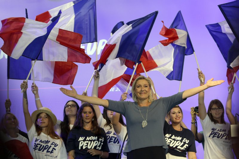 FILE - In this Sunday, Sep. 18, 2016 file photo, far-right National Front president Marine Le Pen, waves to supporters during a meeting in Frejus, southern France. (AP Photo/Claude Paris)