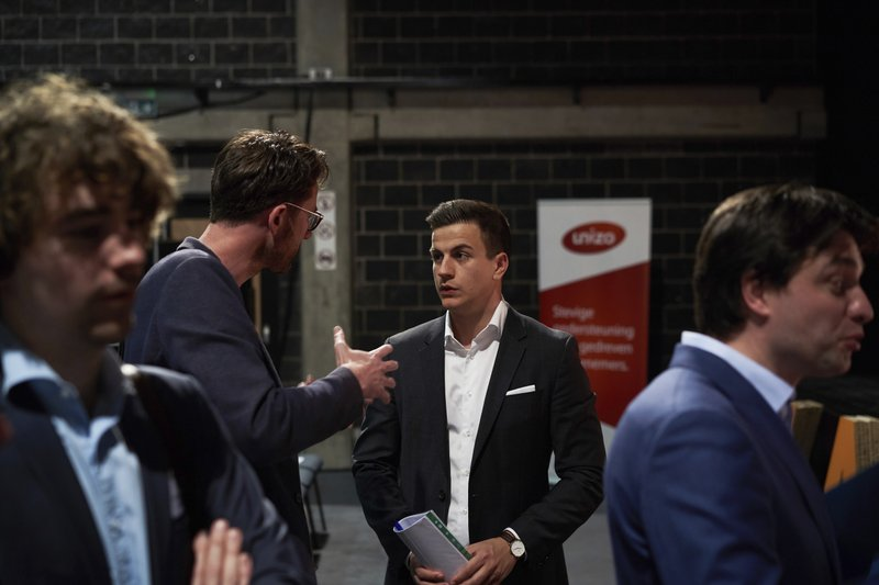 In this April 23, 2019 photo, Vlaams Belang party candidate Dries van Langenhove speaks with attendees at a debate with other party leaders in Zemst, Belgium. (AP Photo/Bram Janssen)