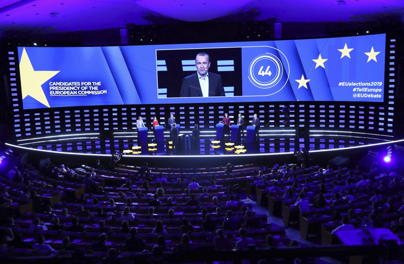 Germany's Manfred Weber of the European People's Party is shown on the large screen as he participates in a debate with other candidates to the presidency of the Commission at the European Parliament in Brussels, Wednesday, May 15, 2019. (AP Photo/Francisco Seco)
