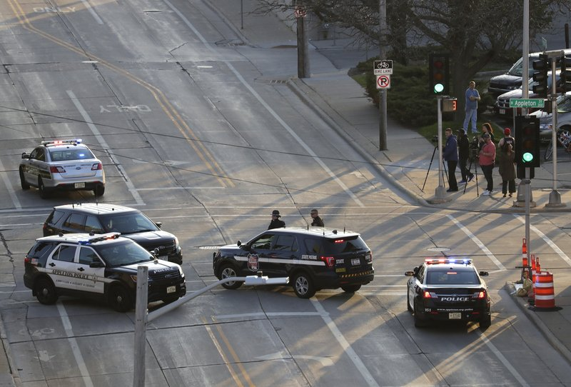 In this Wednesday, May 15, 2019 photo, authorities investigate the scene of a shooting at the Valley Transit Center in Appleton, Wis. (Dan Powers/The Post-Crescent via AP)